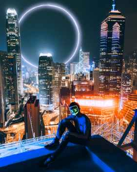 man sitting on top of building